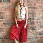baggy hippy pants in bright red with loose low waist and spiritual om print