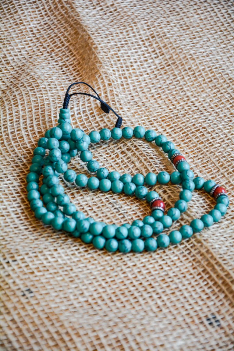 Turquoise gemstone mala prayer beads with red coral divider beads