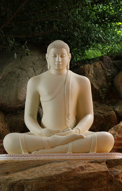 your birthday buddha for thursday. a white carved statue of the buddha meditating